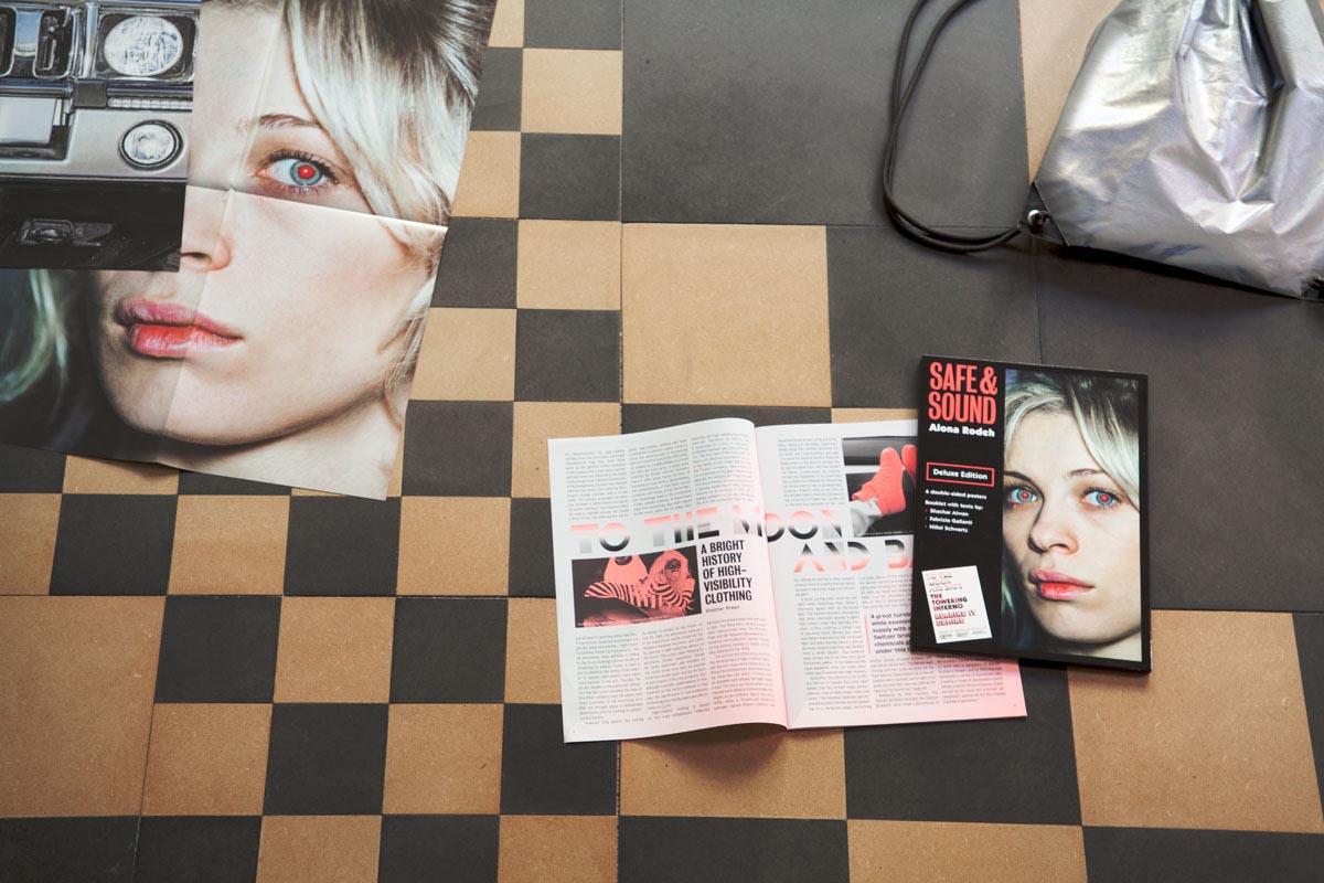 108Safe & Sound Deluxe Edition_2015_B&Natural MDF table, publication, reflective drawstring bag_photo credit Vlad Margulis
